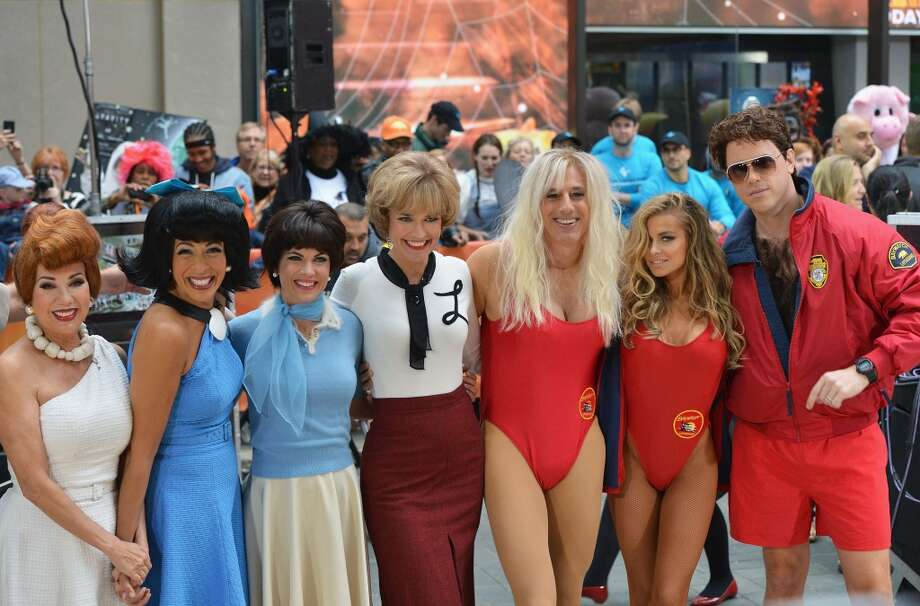 "(L-R) Kathie Lee Gifford, Hoda Kotb, Natalie Morales, Savannah Guthrie, Matt Lauer, Carmen Electra and Willie Geist attend NBC's ""Today"" Halloween 2013 in Rockefeller Plaza on October 31, 2013 in New York City.  (Photo by Slaven Vlasic/Getty Images) Photo: Slaven Vlasic, Getty Images"