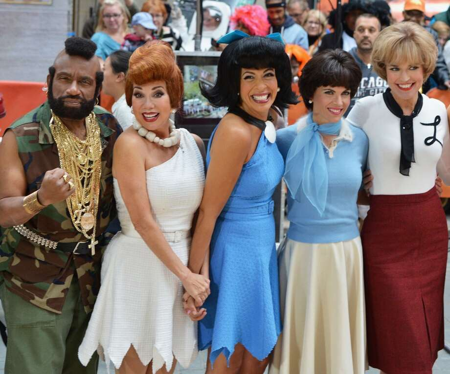 "(L-R) Al Roker, Kathie Lee Gifford, Hoda Kotb, Natalie Morales and Savannah Guthrie attend NBC's ""Today"" Halloween 2013 in Rockefeller Plaza on October 31, 2013 in New York City.  (Photo by Slaven Vlasic/Getty Images) Photo: Slaven Vlasic, Getty Images"