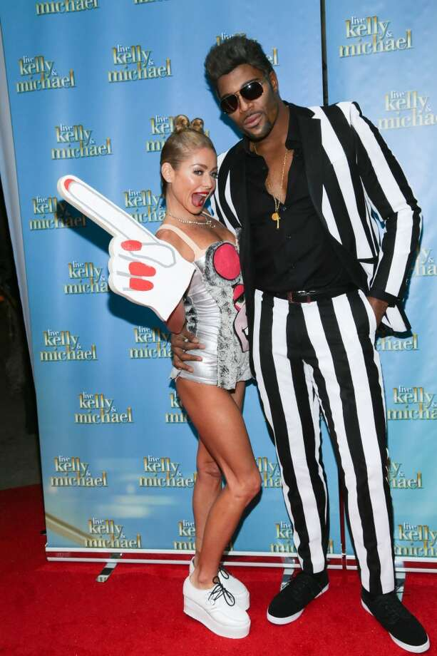 "Kelly Ripa and Michael Strahan attend ""LIVE With Kelly and Michael"": Best Halloween Show Ever at Live with Kelly And Michael Studio on October 31, 2013 in New York City.  (Photo by Rob Kim/Getty Images) Photo: Rob Kim, Getty Images"