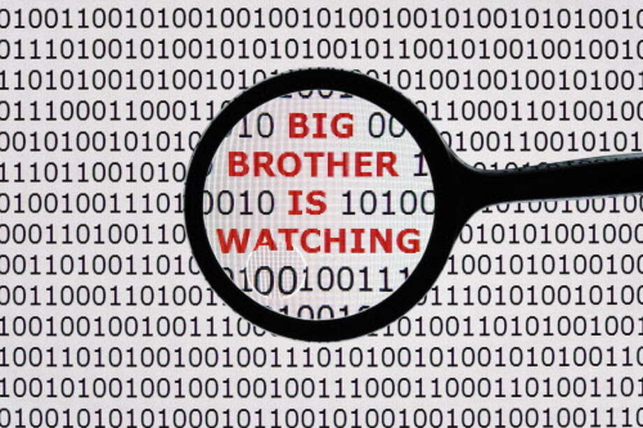 Internet security concept the words big brother is watching on a digital tablet screen with a magnifying glass ORG XMIT: MER2013070512131807 / Brian Jackson - Fotolia
