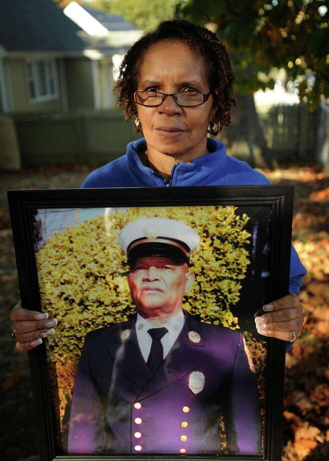 Nell Pettway holds of photo of her recently deceased husband, Earley Pettway, Bridgeport's first African-American deputy fire chief, outside her home in Bridgeport, Conn. on Monday, October 21, 2013. Photo: Brian A. Pounds / Connecticut Post