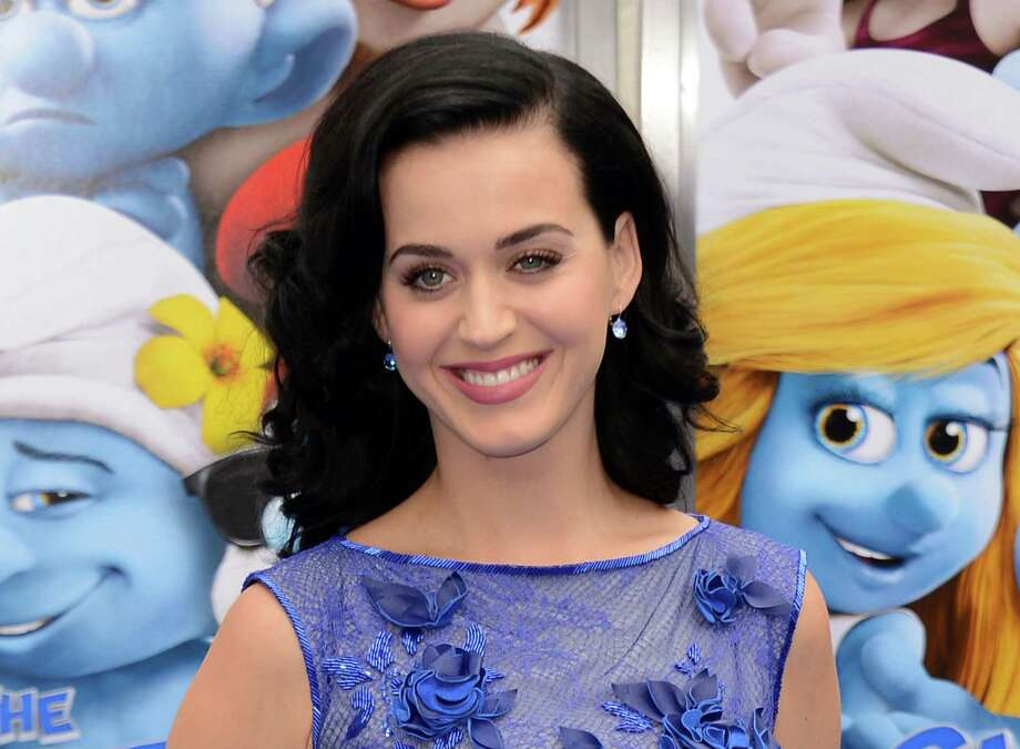 "FILE - This July 28, 2013 file photo shows singer Katy Perry at the world premiere of ""The Smurfs 2"" in Los Angeles. Perry says though she's ""older and wiser,"" she still plans to have fun on her new album. During an interview with an Australian radio show this week, the pop star said she sang backing vocals for Mick Jagger's 2004 song, ""Old Habits Die Hard."" Perry said she had dinner with the veteran rocker and that ""he hit on me when I was 18."" In a statement Thursday, Oct. 31, a representative for Jagger says he ""categorically denies that he has ever made a pass at Katy Perry."" (Photo by Jordan Strauss/Invision/AP, File) ORG XMIT: NYET402 Photo: Jordan Strauss / Invision"