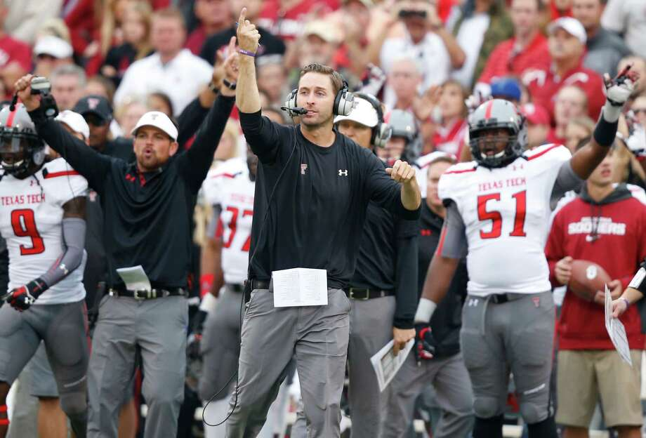 Texas Tech head coach Kliff Kingsbury, center, gestures on the sidelines in the first quarter of an NCAA college football game against Oklahoma in Norman, Okla., Saturday, Oct. 26, 2013. (AP Photo/Sue Ogrocki) Photo: Sue Ogrocki, Associated Press / AP