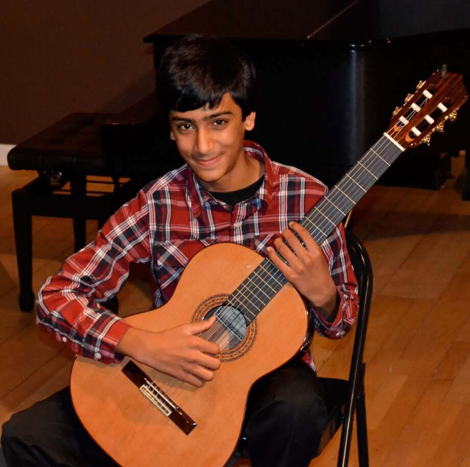 Jaimin Vyas of Fairfield, an accomplished guitarist, will be among the performers at a benefit concert on Nov. 3, 2013, in the Southport section of Fairfield, Conn.