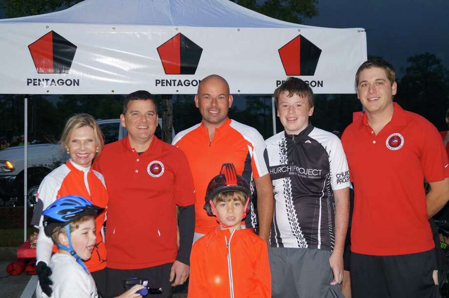 From left, Ann Snyder, James Noack, George Booth, Finlay Booth and Justin Scharnhorst, with (front) Graham Shedden and Magnus Herndon, celebrate Le Tour de Woodlands Oct. 19. Photo: Provided By Interfaith Of The Woodlands