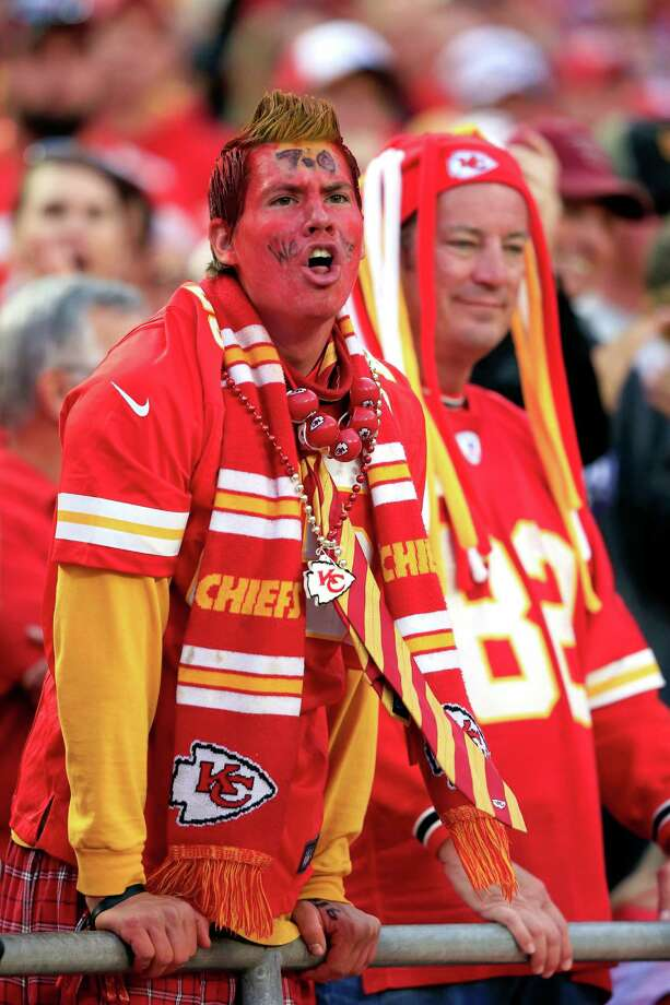 A reader believes that because the Washing-ton Redskins had to change their offensive fight-song lyrics, other football fans — such as these supporting the Kansas City Chiefs  — using ill-advised gestures, should have to stop as well. Photo: Jamie Squire / Getty Images