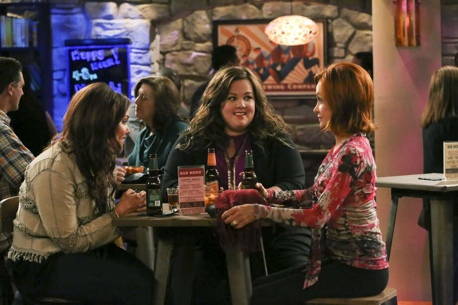 "On ""Mike & Molly,"" Molly (Melissa McCarthy, center), sister Victoria (Katy Mixon, left) and mom Joyce (Swoosie Kurtz) celebrate a life-changing decision Molly has made during a girls' night out. Photo: CBS"