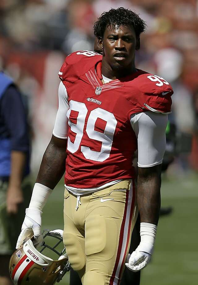 FILE - In this Sept. 22, 2013 file photo, San Francisco 49ers linebacker Aldon Smith (99) stands on the field before an NFL football game against the Indianapolis Colts in San Francisco. Smith turned himself in to Santa Clara County authorities late Tuesday, Oct. 29, 2013, then posted $75,000 bail. Smith was charged Oct. 9 with three felony counts of illegal possession of an assault weapon, stemming from a party at his home in June 2012, and the Santa Clara district attorney's office said at the time it expected him to surrender later in the month. (AP Photo/Marcio Jose Sanchez, File) Photo: Marcio Jose Sanchez, Associated Press