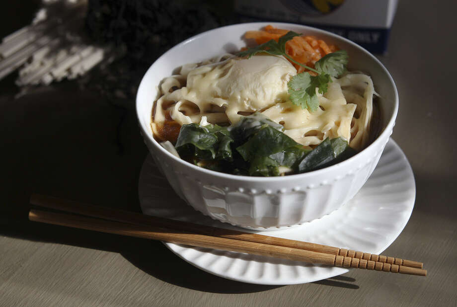 Avocado Café's version of ramen includes cheese, a technique that owner GG Floyd learned while living in Okinawa. Photo: Kin Man Hui/Express-News