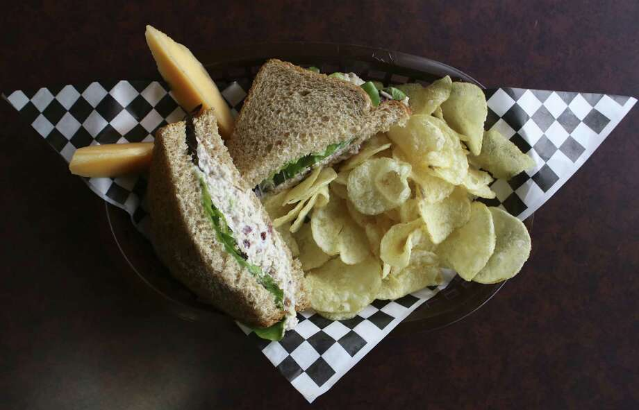A simple chicken salad sandwich balances flavors and textures. All sandwiches here are served with veggie chips. Photo: Photos By Helen L. Montoya / San Antonio Express-News