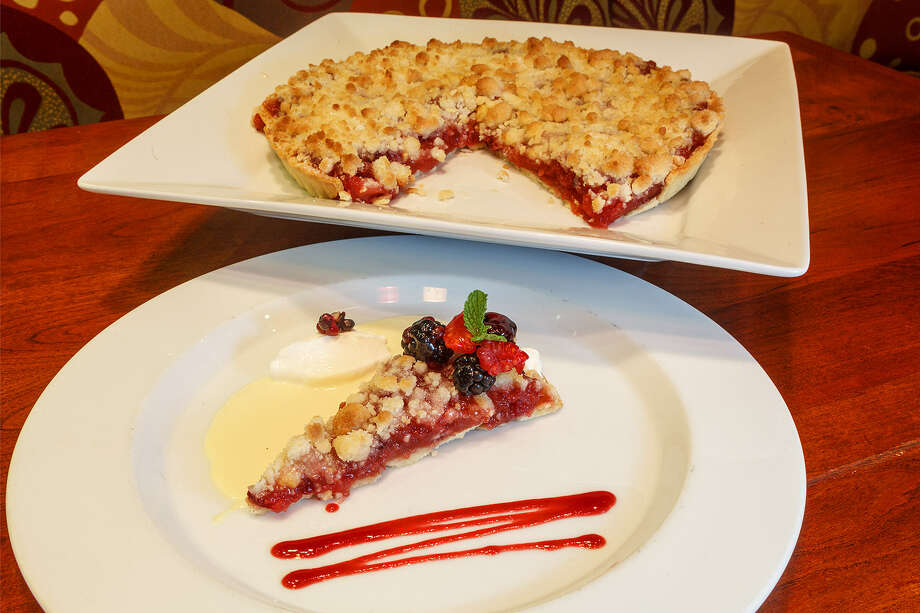The Apple Cranberry Tart at The Grill at Leon Springs is served with crème anglaise and raspberry sauce, a dollop of sour cream and topped with blackberries and raspberries. Photo: Marvin Pfeiffer / San Antonio Express-News