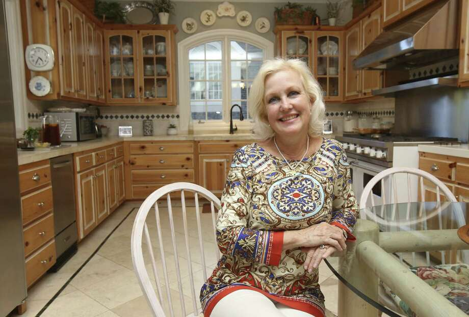 Robbie and Johnny Flume's kitchen grew from a tiny space. It's now ideal to handle cooking for large family gatherings. Photo: Helen L. Montoya / San Antonio Express-News