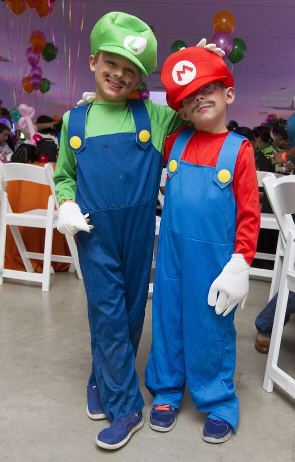 Geurin Houston, 6, and his brother Reid, 5, dress as Luigi and Mario from Super Mario Brothers Photo: J. Patric Schneider, For The Chronicle