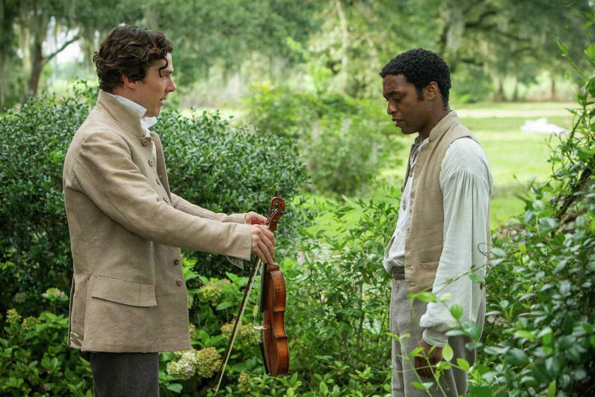 """This image released by Fox Searchlight shows Benedict Cumberbatch, left, and Chiwetel Ejiofor in a scene from """"12 Years A Slave."""" (AP Photo/Fox Searchlight, Jaap Buitendijk) ORG XMIT: NYET203"""