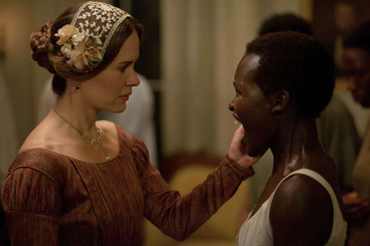 """This image released by Fox Searchlight shows Sarah Paulson, left, and Lupita Nyong'o in a scene from """"12 Years A Slave."""" (AP Photo/Fox Searchlight, Francois Duhamel) ORG XMIT: NYET205"""