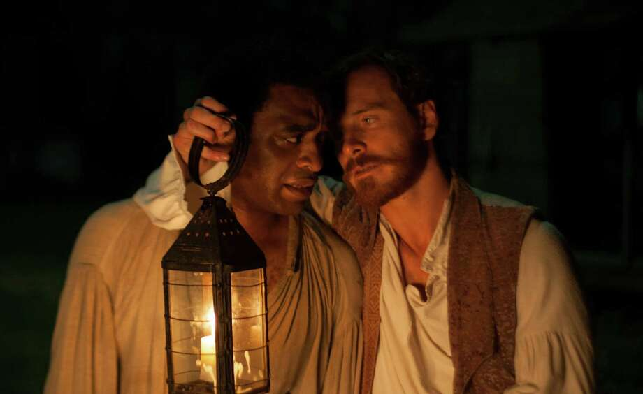 "This image released by Fox Searchlight shows Chiwetel Ejiofor, left, and Michael Fassbender in a scene from ""12 Years A Slave."" (AP Photo/Fox Searchlight, Francois Duhamel) ORG XMIT: NYET202 Photo: Francois Duhamel / Fox Searchlight"