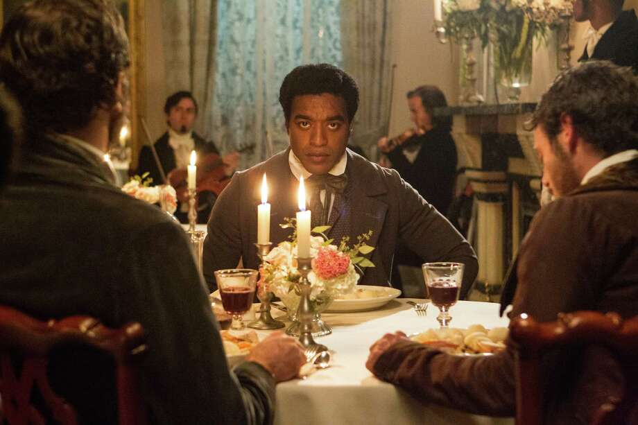 "This image released by Fox Searchlight shows Chiwetel Ejiofor in a scene from ""12 Years A Slave."" (AP Photo/Fox Searchlight, Jaap Buitendijk) ORG XMIT: NYET201 Photo: Jaap Buitendijk / Fox Searchlight"