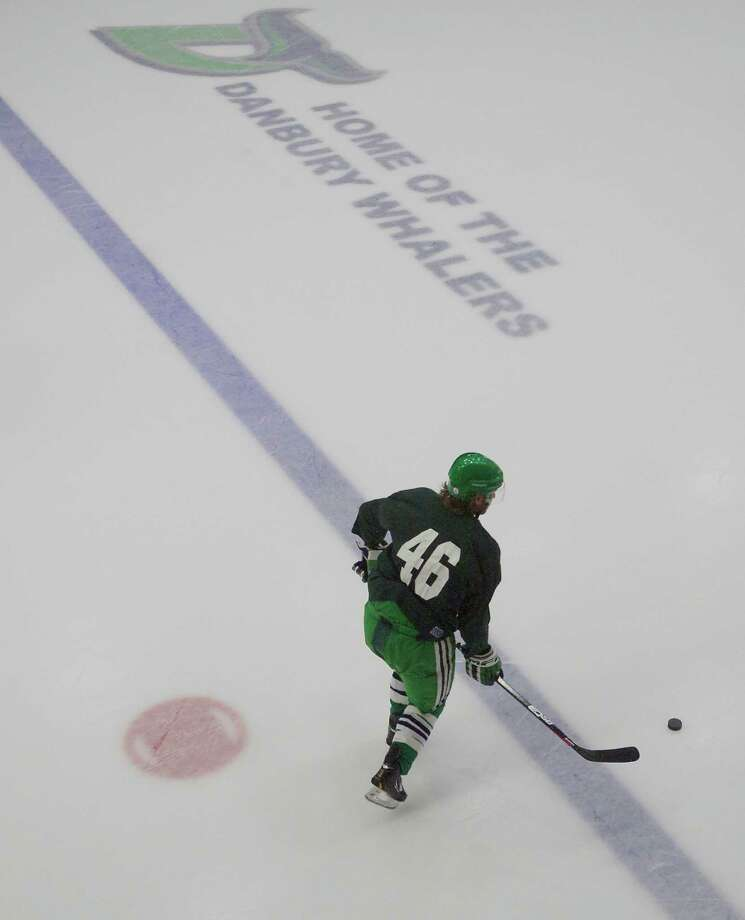 Brad Barber skates with the puck during the Danbury Whalers hockey team practice in the Danbury Arena, Danbury, Conn, on Thursday, October 31, 2013. Photo: H John Voorhees III / The News-Times Freelance
