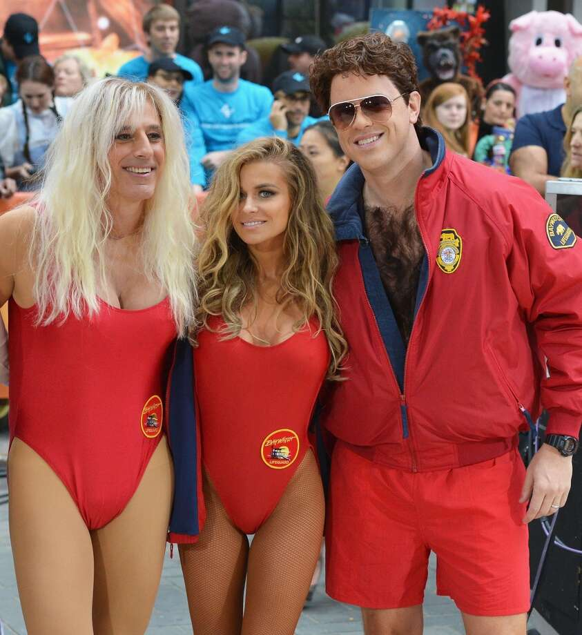 "(L-R) Matt Lauer, Carmen Electra and Willie Geist, dressed as 'Baywatch' characters attend NBC's ""Today"" Halloween 2013 in Rockefeller Plaza on October 31, 2013 in New York City.  (Photo by Slaven Vlasic/Getty Images) Photo: Slaven Vlasic, Getty Images"