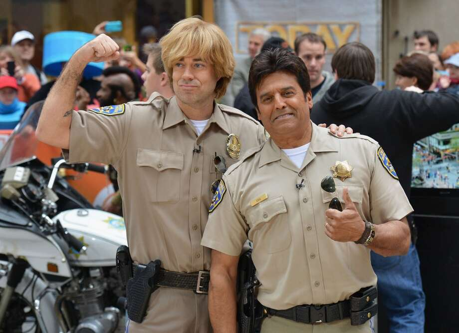 "Carson Daly (L) and Erik Estrada, dressed as characters from CHiPs, attend NBC's ""Today"" Halloween 2013 in Rockefeller Plaza on October 31, 2013 in New York City.  (Photo by Slaven Vlasic/Getty Images) Photo: Slaven Vlasic, Getty Images"