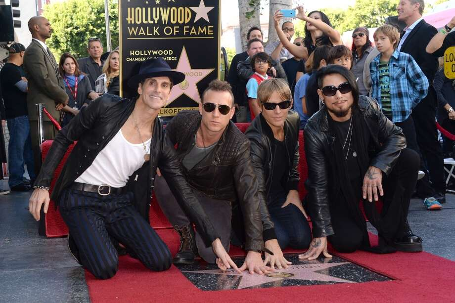 (L-R) Musicians Perry Farrell, Stephen Perkins, Chris Chaney and Dave Navarro attend the ceremony honoring them with a Star on The Hollywood Walk of Fame on October 30, 2013 in Hollywood, California. (Photo by Jason Merritt/Getty Images) Photo: Jason Merritt, Getty Images