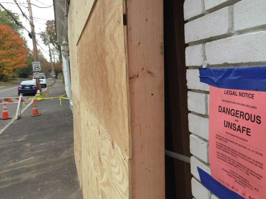 The storefront at 60 Pemberwick Road, which town building officials declared unsafe for occupancy. Photo: Justin Pottle, Greenwich Time / Greenwich Time
