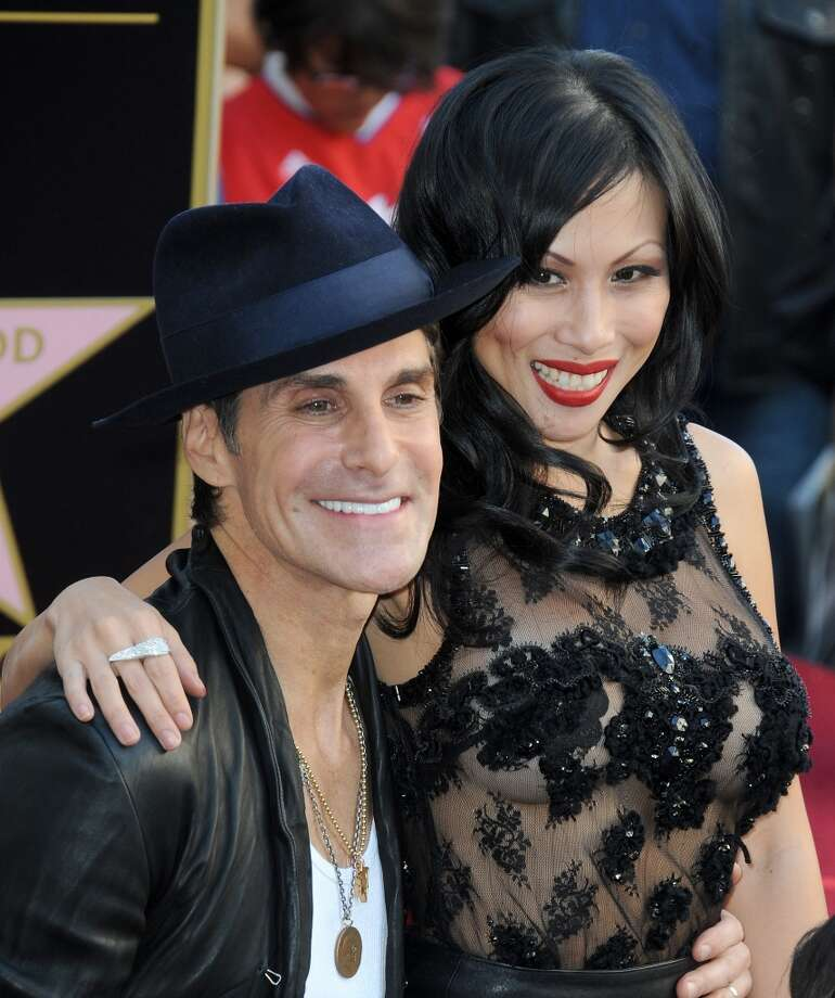 Lead singer Perry Farrell and wife Etty Lau Farrell of Jane's Addiction Honored On The Hollywood Walk Of Fame on October 30, 2013 in Hollywood, California.  (Photo by Albert L. Ortega/Getty Images) Photo: Albert L. Ortega, Getty Images
