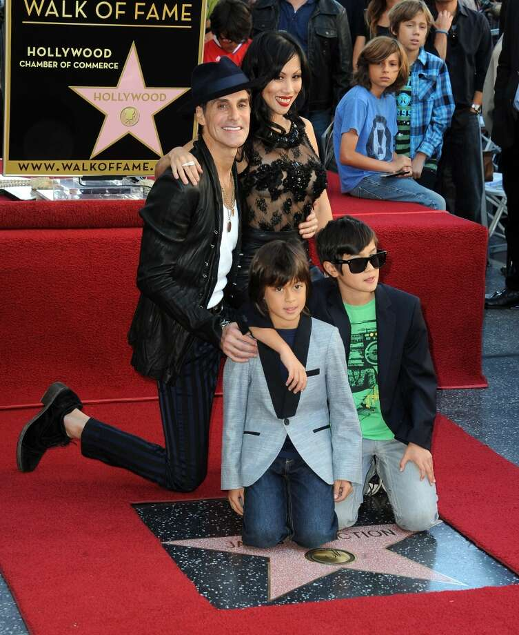 Lead singer Perry Farrell, wife Etty Lau Farrell ands sons Izzadore Bravo Farrell, Hezron Wolfgang Farrell attend as Jane's Addiction is Honored On The Hollywood Walk Of Fame on October 30, 2013 in Hollywood, California.  (Photo by Albert L. Ortega/Getty Images) Photo: Albert L. Ortega, Getty Images