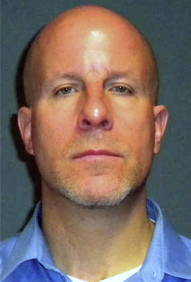 This booking photo provided by the Fairfield Police Department shows former Fairfield Ludlowe High School teacher Glenn Mishuck, of Bridgeport, Conn. Mishuck, 47, was arrested and charged Thursday, Oct. 31, 2013 with sexual assault after an investigation determined he had a sexual relationship with an under-aged female student. Photo: AP Photo/Fairfield Police Department, Fairfield Police  / Associated Press