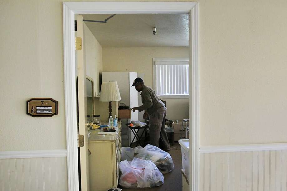 Burton Nash removes personal items left behind by his elderly parents, Eddie and Vernetta Nash in their room in the abandoned Valley Springs Manor building October 31, 2013 in Castro Valley, Calif. Nash's parents moved into the facility in July and have recently been relocated to a new care facility after Valley Springs Manor was abandoned by most of its staff last weekend. Photo: Leah Millis, The Chronicle