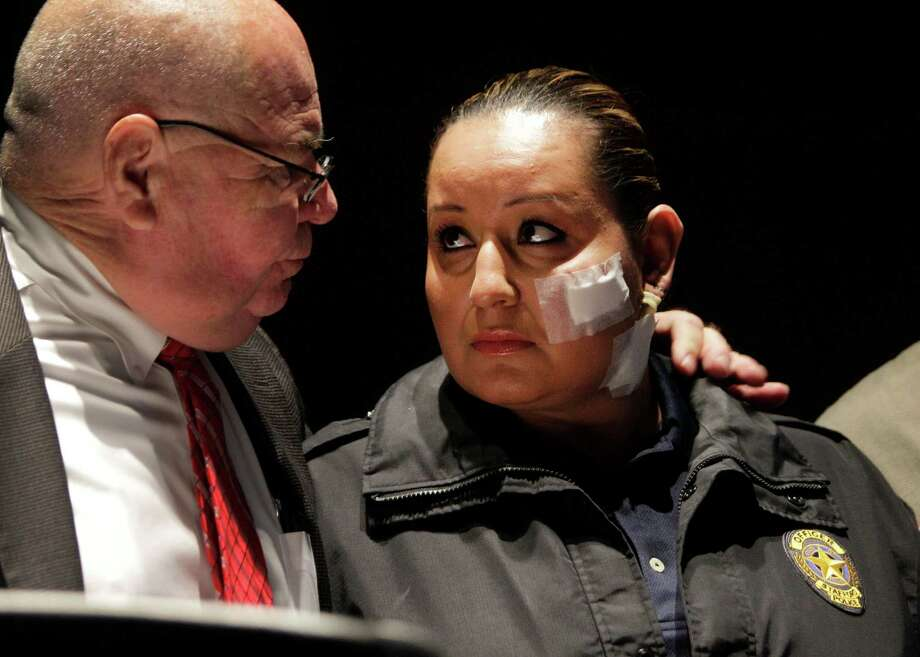 Stafford Police Chief B.R. Krahn, left, comforts and keeps a hand on the shoulder of Stafford Police officer Ann Carrizales, right, as the dash cam video of her being shot is shown during media conference at the Stafford Centre, 10505 Cash Road, Thursday, Oct. 31, 2013, in Stafford.  Officer Carrizales was shot and wounded during a traffic stop on Oct. 26. Photo: Melissa Phillip, Houston Chronicle / © 2013  Houston Chronicle