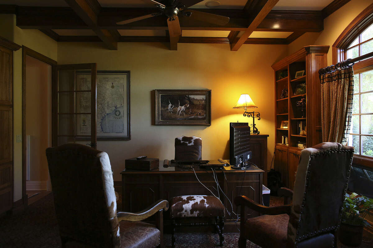 The office features a coffered ceiling and warm colors.