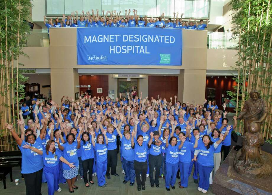 Staff members at Houston Methodist Willowbrook Hospital celebrate the hospital's magnet status. Photo: Provided By Houston Methodist Willowbrook Hospital