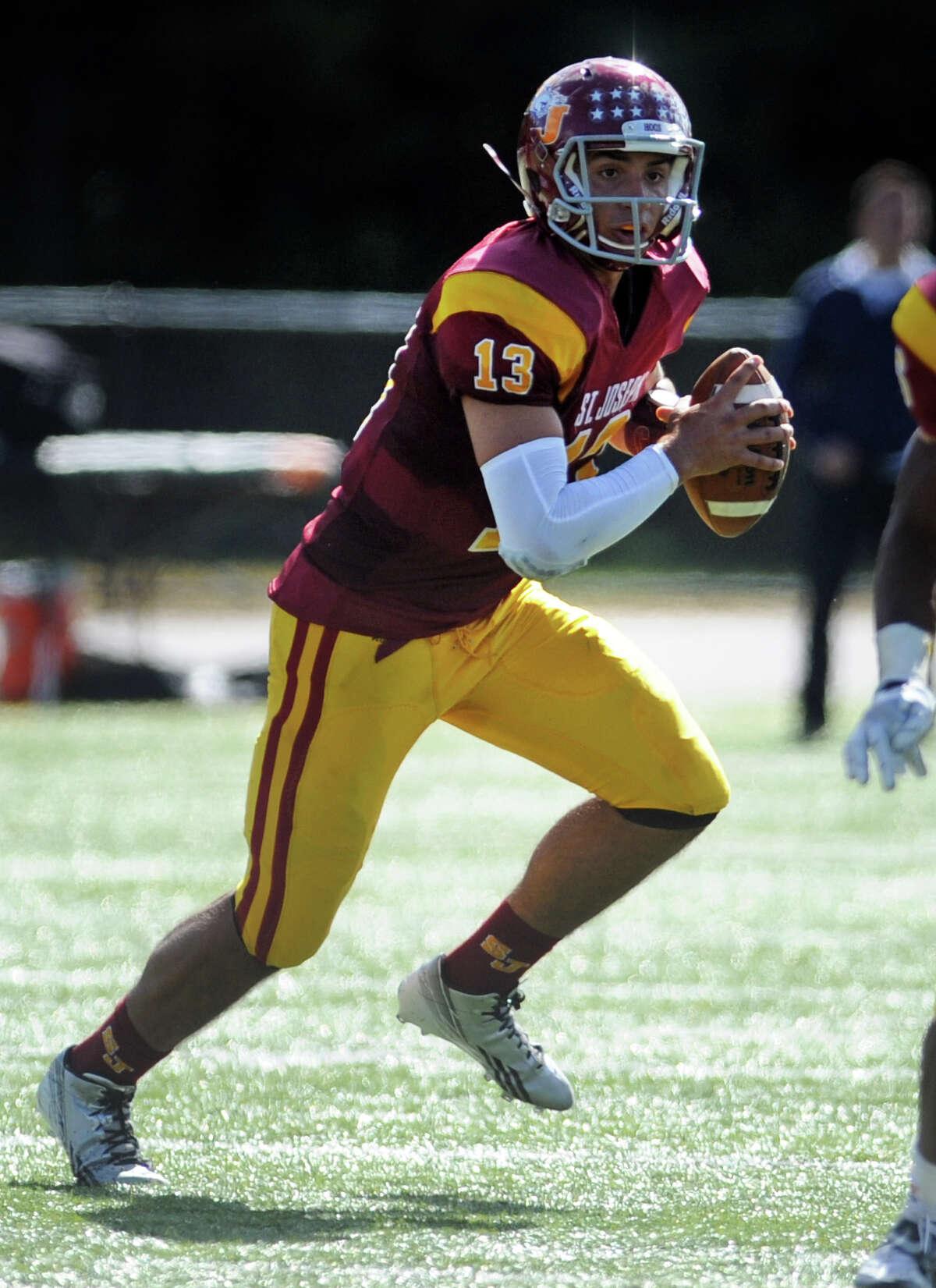 St.Joseph quarterback Jordan Vazzano looks to pass against Ridgefield Saturday, Sept. 28, 2013 at St. Joseph High School in Trumbull, Conn.
