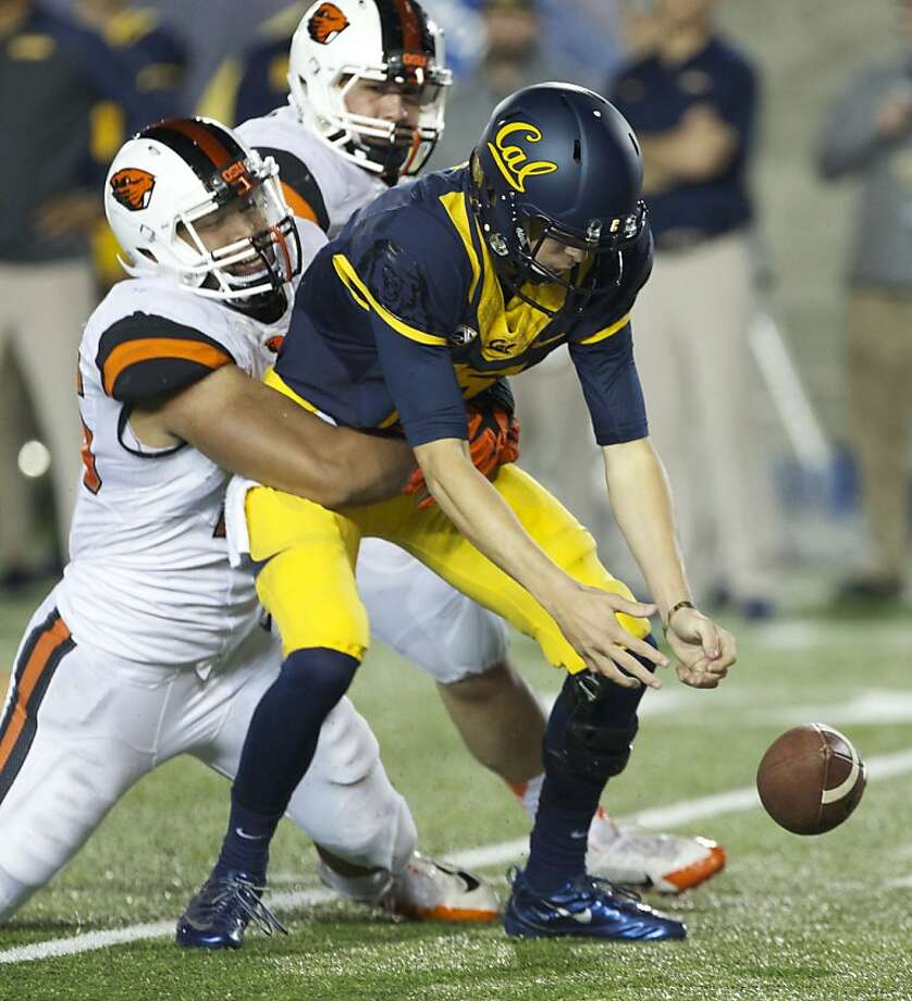 Cal freshman quarterback Jared Goff, left, has impressive statistics to go along with his low moments, such as this sack/fumble against Oregon State. Stanford wide receiver Kodi Whitfield, right, made one of the finest catches of the year, a one-handed grab with UCLA's Ishmael Adams defending. Photo: Randy L. Rasmussen, Associated Press