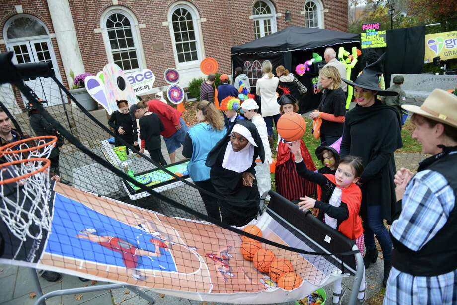 Kids in costume play games outside of Edmond Town Hall during Halloween trick-or-treat night in Newtown, Conn. on Thursday, Oct. 31, 2013.  After being cancelled the last two years due to poor weather conditions, hundreds of Newtown children and parents came out in costume this year, going door to door down Main Street. Photo: Tyler Sizemore / The News-Times