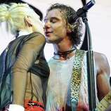Gwen Stefani and Gavin Rossdale met while her band No Doubt was opening for his band Bush in 1995. The couple married in 2002 and went on to have two sons, Kingston and Zuma, and Stefani is pregnant with their third. Here they are performing at the 2012 KROQ Acoustic Xmas show.
