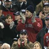 Actors Jennifer Garner and Ben Affleck sit at Game 2 of the World Series between the Red Sox and St. Louis Cardinals at Fenway Park in 2004.