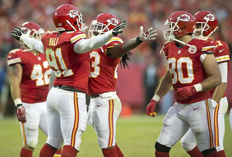 Linebacker Tamba Hali (No. 91) and Kendrick Lewis of the Chiefs bump chests. They're part of a very good defense. Photo: David Eulitt, McClatchy-Tribune News Service