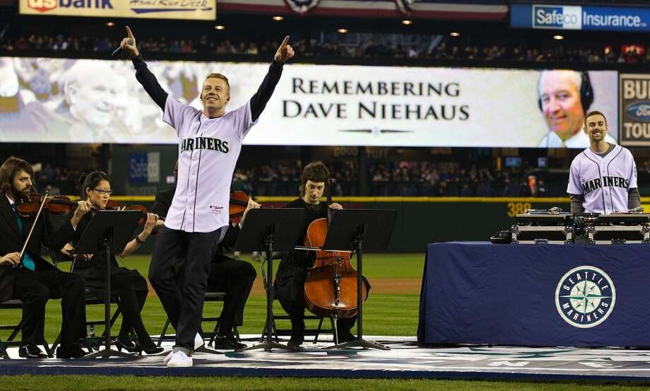 Seattle musician Macklemore performs a tribute to Dave Niehaus during Opening Day ceremonies at Safeco Field in Seattle Friday April 8, 2011. Photo: Stephen Brashear, STEPHEN BRASHEAR