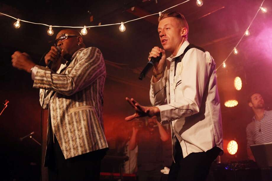 Wanz (L) and Macklemore perform onstage at the iHeartRadio Official SXSW Showcase on March 12, 2013 in Austin, Texas.  (Photo by Roger Kisby/Getty Images for iHeartradio) Photo: Roger Kisby