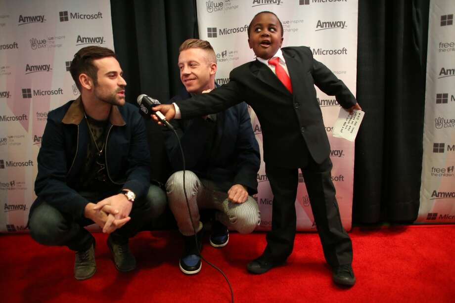 Ryan Lewis and Ben Haggerty, aka Macklemore, are interviewed by Robbie Novak, aka Kid President, during We Day on Wednesday, March 27, 2013 at KeyArena in Seattle. The event brought thousands of middle and high school students together to hear from a list of celebrities and motivational speakers. We Day is a youth educational and empowerment event organized by the Free the Children charity. Students earn a seat at the event through their commitment to do good. (Joshua Trujillo, seattlepi.com) Photo: JOSHUA TRUJILLO