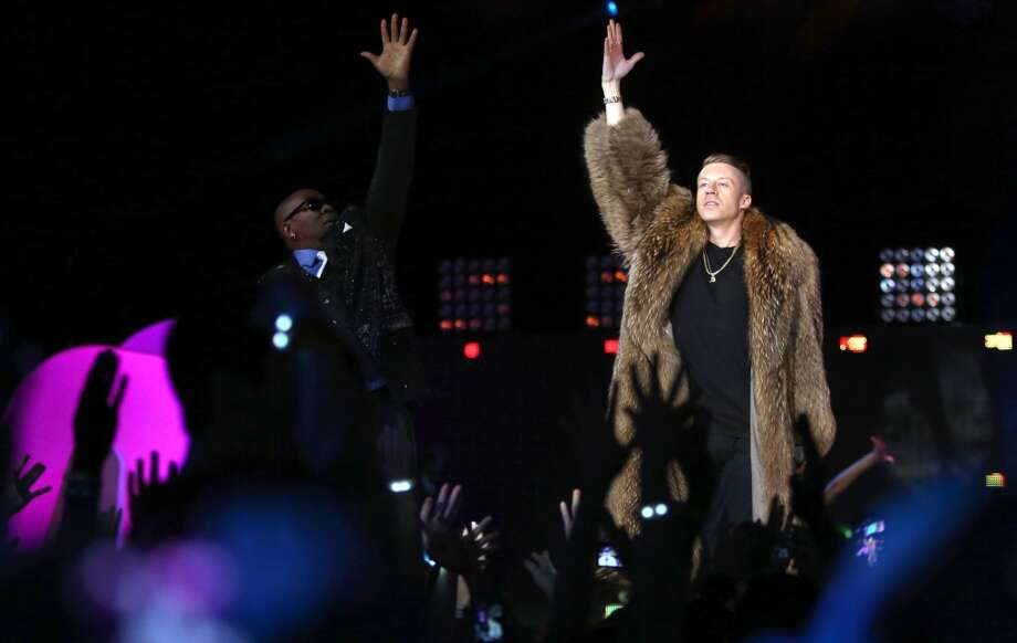 "Wanz and Macklemore perform their song ""Thrift Shop"" during We Day on Wednesday, March 27, 2013 at KeyArena in Seattle. The event brought thousands of middle and high school students together to hear from a list of celebrities and motivational speakers. We Day is a youth educational and empowerment event organized by the Free the Children charity. Students earn a seat at the event through their commitment to do good. (Joshua Trujillo, seattlepi.com) Photo: JOSHUA TRUJILLO"