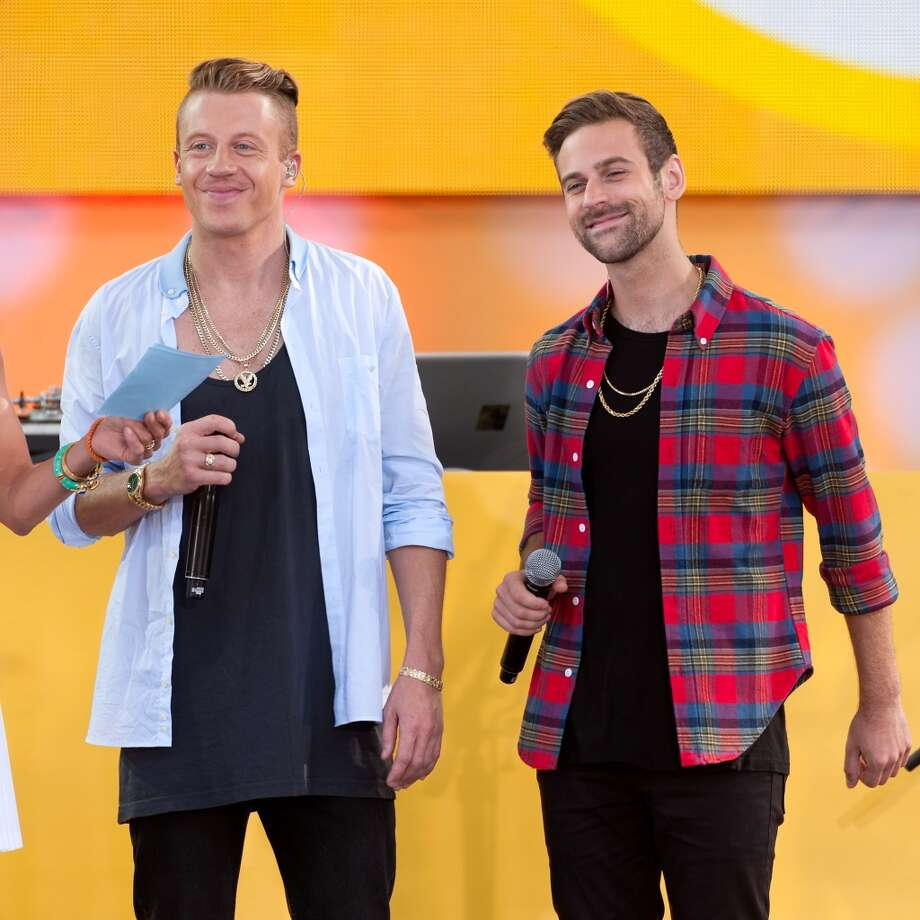 "Macklemore (L) and Ryan Lewis perform on ABC's ""Good Morning America"" at Rumsey Playfield, Central Park on August 16, 2013 in New York City.  (Photo by D Dipasupil/FilmMagic) Photo: D Dipasupil, FilmMagic"