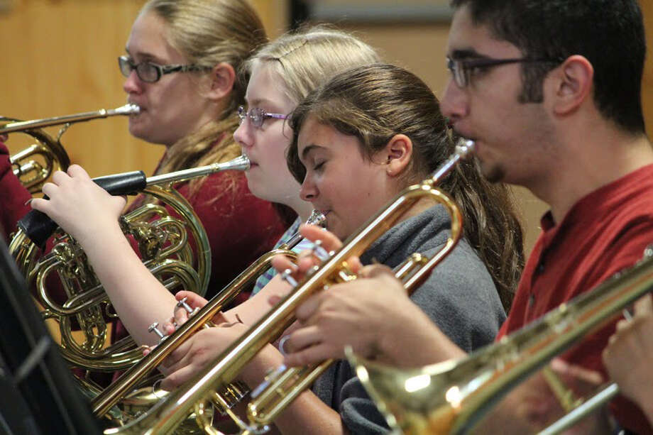 The Greater Bridgeport Youth Orchestras opens its 2013-14 season on Sunday afternoon, Nov. 10, in Bridgeport. Above are members at a recent practice session. Photo: Contributed Photo / Connecticut Post Contributed