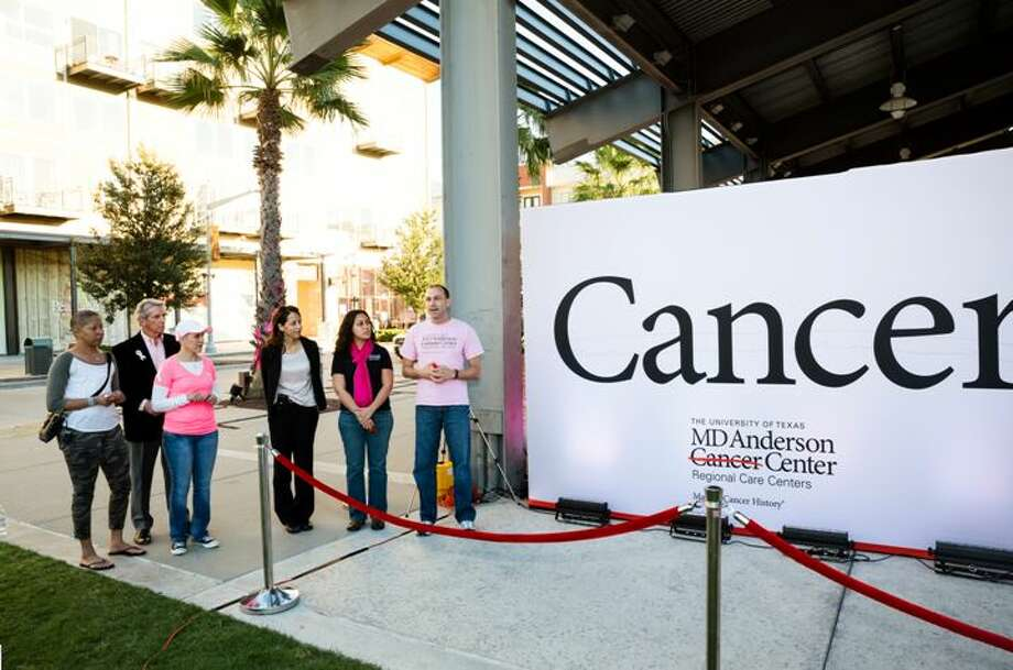 From left, Marnie Yancy, Ron Lauve, Myrna Montes, Dr. Valerie Reed, Dr. Amy Hassan and Dr. Richard Ehlers stand by MD Anderson's interactive art display. Photo: Provided By MD Anderson Regional Care Center