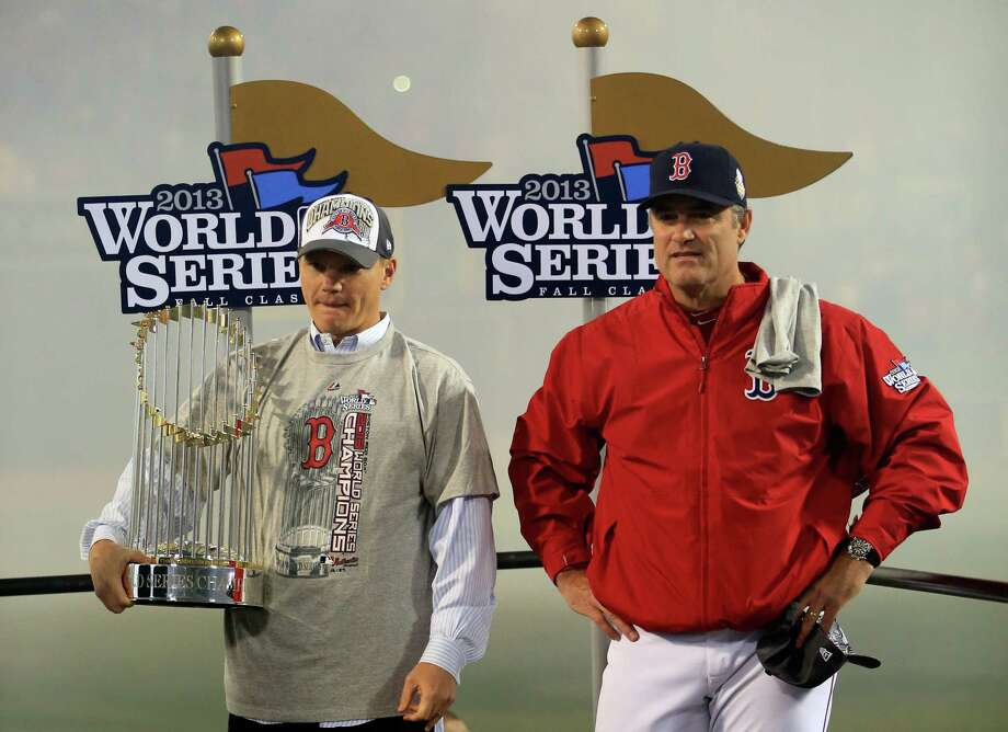 Red Sox general manager Ben Cherington (left) and manager John Farrell took the team from last in the AL East in 2012 to a World Series title. They face big decisions again this offseason. Photo: Jamie Squire / Getty Images