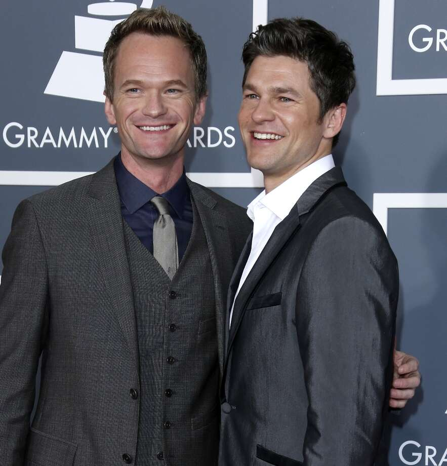 Neil Patrick Harris and David Burtka began dating in 2004. In 2010, they welcomed twins, a boy and a girl. The following year, after the passage of the Marriage Equality Act in New York, the couple announced their engagement and were married in 2014. Photo: Dan MacMedan, WireImage / 2013 Dan MacMedan