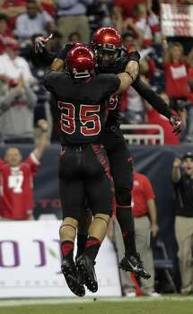 Cougars running back Kenneth Farrow left, celebrates with teammate Xavier Maxwell right, after Farrow scored a touchdown. Photo: James Nielsen, Houston Chronicle