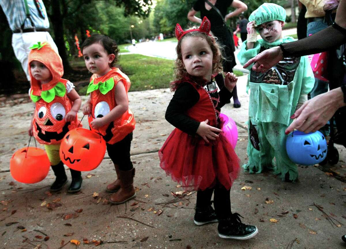Victoria Ruiz, dressed as a red devil, trick-or-treats with her family Halloween night in The Woodlands, Tx.